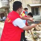开封市儿康中心开展清洁社区志愿服务